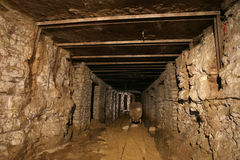 Mine. A tunnel in an old oil shale mine stock images