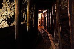 Mine tunnel with path - historical gold, silver, copper mine Stock Photos
