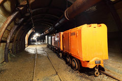 Mine with wagons. Mine tunnel with train and wagon stock images