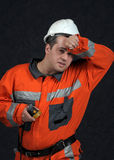 Mine worker sweaping. Mine worker exhausted sweaping sweat with left arm stock photos