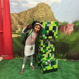 Minecraft Girl with Creeper. Young cute girl in costume hugs creeper at Wizard World in Portland Oregon Stock Images
