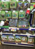 Minecraft toys figures and merchandise. Shelves of minecraft toys including figures and general merchandise Stock Photos