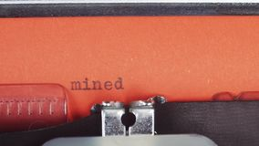 Mined - Typed on a old vintage typewriter. Printed on red paper. The red paper is inserted into the typewriter stock video footage