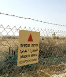 Minefield sign. In Hebrew, Arabic, English and Russian in Jordan valley, Israel Stock Photo