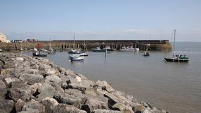 Minehead harbour Somerset England with boats in summer with blue sky stock footage