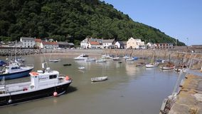 Minehead harbour Somerset England with boats in summer PAN stock footage