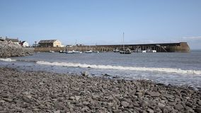 Minehead harbour Somerset England with boats in summer at sea level stock video