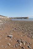 Minehead Somerset England uk beach pebbles and rocks and sea. Minehead harbour Somerset England uk in summer with blue sky on a beautiful day Royalty Free Stock Images