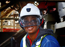 Miner. An african female miner clothed in all the safety gear Stock Photos