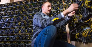 Miner bitcoin cryptocurrency. Farm mining virtual money Stock Photo
