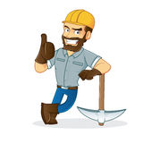Miner leaning on pickax Stock Images