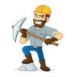 Miner holding pickax  stepping on rock Royalty Free Stock Photos