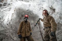 Miner inside a gold mine. Royalty Free Stock Photography