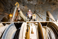 Miner inside a gold mine. Royalty Free Stock Images