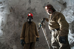 Miner inside a gold mine. Siberia, Russia - August 2014: Miner poses for a photograph inside a gold mine Royalty Free Stock Image