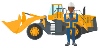 Miner with mining equipment on background. Royalty Free Stock Photos