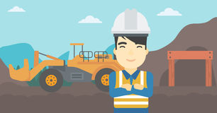 Miner with mining equipment on background. Royalty Free Stock Image