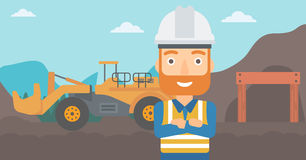 Miner with mining equipment on background. Royalty Free Stock Images