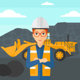 Miner with mining equipment on background. Royalty Free Stock Photo