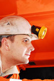 Miner operating a machine Royalty Free Stock Photo