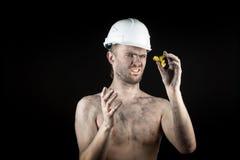 Miner shows a golden nugget Stock Photos