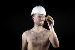 Miner shows a golden nugget Stock Photo