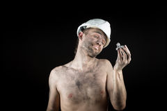 Miner shows a silver nugget Royalty Free Stock Photo