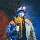 Miner underground mining gold Royalty Free Stock Photography