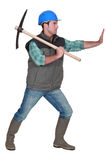 Miner using pick-Axe Stock Photography
