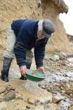 Miner washing gold in Tierra del Fuego. Royalty Free Stock Image