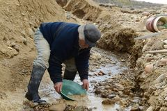 Miner washing gold in Tierra del Fuego. Stock Photos