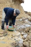 Miner washing gold in Tierra del Fuego. Royalty Free Stock Photography