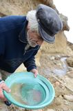 Miner washing gold in Tierra del Fuego. Stock Photography