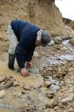Miner washing gold in Tierra del Fuego. Royalty Free Stock Photo