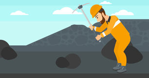 Miner working with pick. Stock Images