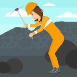 Miner working with pick. Royalty Free Stock Images