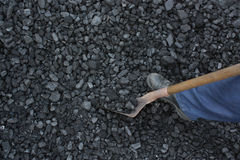 Miner working. At shoveling coal mine Royalty Free Stock Image