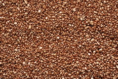 Mineral background. The multicoloured  pebbles , natural minerals, of grain of gold Stock Image