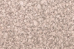 Mineral background with red or pink granite stone texture Royalty Free Stock Photo