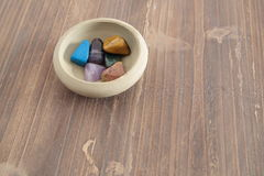 Mineral colors on a clay bowl Stock Images