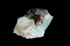 Mineral del cuarzo aislado en balck Imagen de archivo