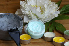 Mineral face and body mask, scrab and candles Stock Images
