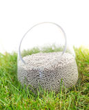 Mineral fertilizer on grass Stock Photography