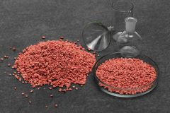 Mineral fertilizer with phosphorus in red with chemical glass royalty free stock photography