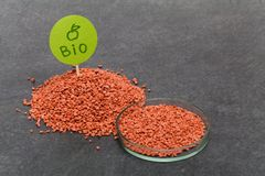 Mineral fertilizer with phosphorus in red with chemical glass stock photo