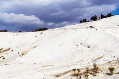 The mineral hillside of Pamukkale. The amazing hillside of Pamukkale was formed by mineral-rich water dripping down years after years, building the unique stock photography