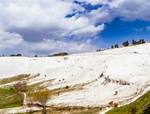 The mineral hillside of Pamukkale. The amazing hillside of Pamukkale was formed by mineral-rich water dripping down years after years, building the unique royalty free stock photo