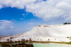 The mineral hillside of Pamukkale. The amazing hillside of Pamukkale was formed by mineral-rich water dripping down years after years, building the unique stock photos
