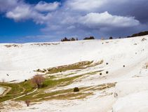 The mineral hillside of Pamukkale. The amazing hillside of Pamukkale was formed by mineral-rich water dripping down years after years, building the unique royalty free stock images
