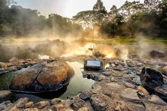 Mineral hot water in hot springs and morning fog background at Chae Son National Park stock photography